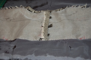 "The ""couture-constructed"" neckline, before the lining is attached."