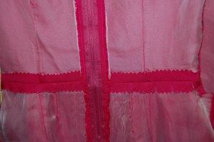 "An interior view of some ""couture"" construction - silk organza underlining, catch-stitched seams, hand-picked zipper."