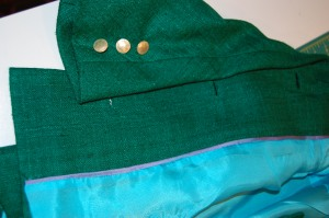 The gold buttons added to the sleeves and another view of the lining (and the back of the bound buttonholes).