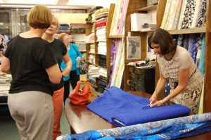 Alice is on the right, in a pose seen often - cutting fabric.