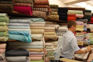 Pierre shown here in front of all those luscious fabrics.