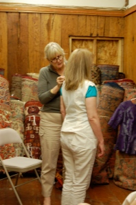 Susan making adjustments in Diane's muslin.