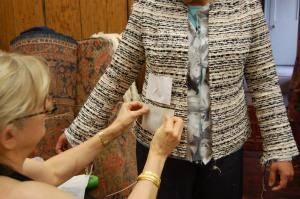 Susan helps Myra pin pocket templates onto her jacket.