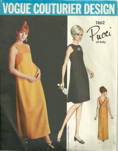 """Slim, high fitted dress in evening r street length has wrapped back closing, soft side back folds."""