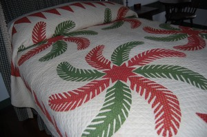 Here is a large classic red and green antique Princess Feather quilt from a private collection.