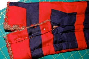 Here is the separate lining piece being applied to the placket.