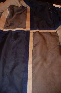 Here is the inside of the back of the coat, with the seams catch-stitched to the organza.