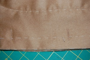 The buttonholes show up better on the camel wool. Click on the photo for a close-up.