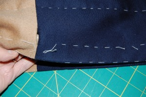The middle buttonhole is a slot-seam one.