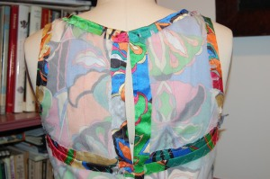 This back view also shows the extended armhole line.
