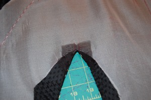 The organza patch is sewn on the right side of the jacket and pressed to the inside.