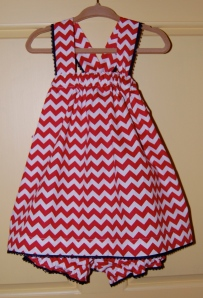 The shoulder straps twist through loops in the back and become the sash for the dress.