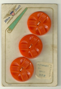 This card of buttons cost 2 cents originally!  They seem to mimic the small orange explosions on the dress fabric.