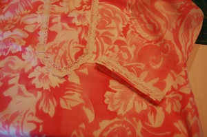 I attached the lace with the straight edge at the bottom of the sleeve, with a narrow margin of fabric showing,