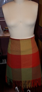 I wrapped the blanket around myself in the store - as a skirt - to test my theory.  Here it is pinned on my dress form