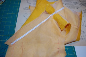 "I basted the twill tape just to the outside of the fold line on the ""all-in-one"" facing."