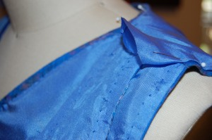 The shoulder seam encloses two finished layers in front.