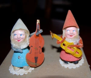 The little guy in blue doesn't look too worried about his broken instrument!