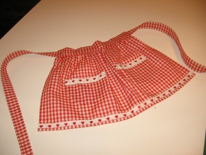I found the red gingham in one of my fabric drawers, and I purchased yards and yards of the heart lace when Waechter's (sadly) went out of business.