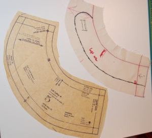 This shows not only the added curve to the collar end, but also how much width I had to remove from the collar pattern
