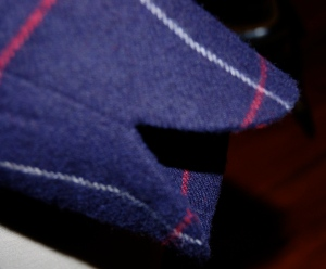 This shows the curved detail on the edge of the sleeve.
