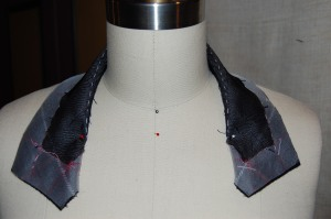 A dress form is indispensable for steaming the undercollar.  You can see the basted roll lie in this photo.