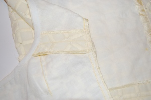 I made a bias tape out of the underlings fabric to bind the neck edge.  Seam edges are encased in Hug Snug.