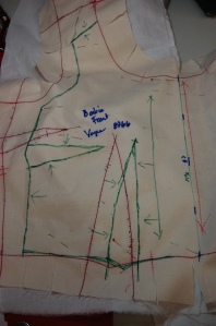 The pattern for the over bodice needed major adjustments.  Here is the front . . .