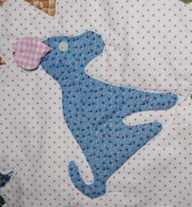 The dog's ear is floppy! I lined it with pink gingham. Here i have it pinned back so you can see it!