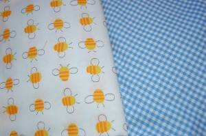 The buzzy bee fabric is a vintage cotton. The blue gingham is new.