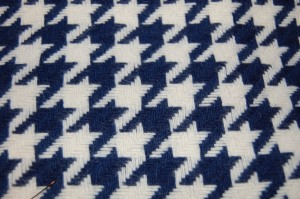 Navy and white houndstooth.