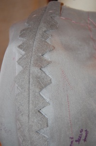 The benefits of a silk organza interlining (or underlining) are manifold, but not least of which is a foundation upon which to secure the seams.