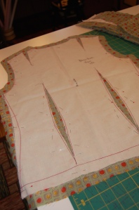 This shows my muslin pattern, cut on the seam lines, and with the darts cut out, so that I could tread trace along all sewing lines.