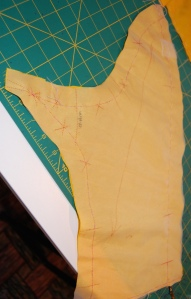 Here is that sleeve piece in the fashion fabric, with silk organza underlining basted to it.