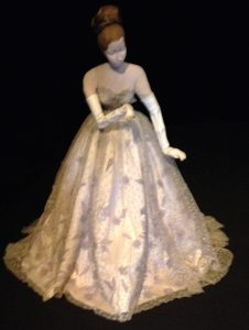 Ball gown by Lucien LeLong, with white kid gloves and pink slippers