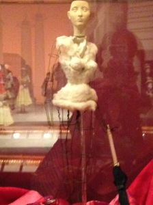 "One of the glass cases in the Exhibit shows a ""naked"" mannequin, which gives one a good look at what the fashion designers and ""petit mains"" were working with while dressing them."