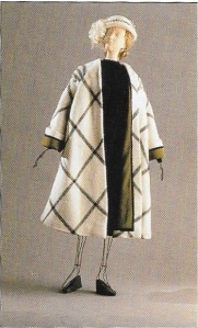Here is an example of one of the fashions which was not on display, but pictured in the catalogue. This raglan sleeve windowpane check coat is by Alex. Coats similar to this were so in vogue in the 1950s!