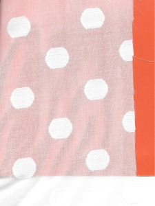 I backed this fabric with a piece of orange paper so that the polka dot design shows. The dots are woven into this fine cotton from Britex Fabrics.